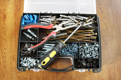 Box with various screws and workiong tools Royalty Free Stock Image