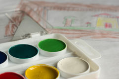 Box with water color paints and children's drawing Royalty Free Stock Image