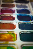 Box of watercolors. Paint brush on the box of watercolors Royalty Free Stock Images