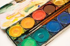 Box of Watercolors. With two brushes on white background Royalty Free Stock Image