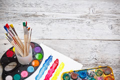 Box of watercolors and paintbrushes Stock Photos