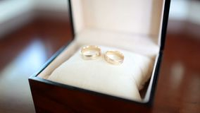 Box with wedding gold rings. Close up stock video footage