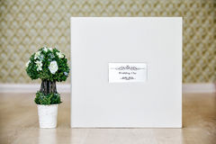 Box for wedding photo album with leather cover and metal shield Royalty Free Stock Photos