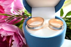 Box with wedding rings and flowers. Closeup Stock Photo