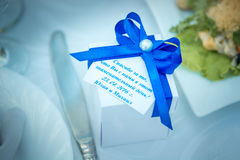 Box on the wedding table. Wedding Table display with wedding Favor box on a bone china plate Stock Image