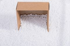 Box on white polystyrene foam balls. Box on little  white polystyrene foam balls Royalty Free Stock Image