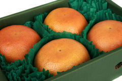 Box of whole grapefruit Royalty Free Stock Images