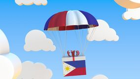 Box With National Flag Of The Philippines Falls With A Parachute. 3D Rendering Royalty Free Stock Images