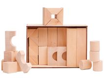 Box with wooden figures on white isolated background. A box with wooden figures beside lie geometric figures for the development of a child on a white isolated stock images