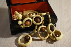 Box with wooden ornaments for women. Wooden jewelry boxes will be a great addition to the classic style in the interior. An important feature of this accessory stock images