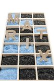 Box with word MATRIX in the Sand. Low angle view on a wooden box of square compartments rectangular compartments filled with blue or black decorative sand as stock photography