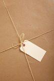 A box wrapped in brown paper with blank tag Stock Photos
