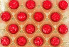 Box of wrapped chocolate in red Christmas decoration Royalty Free Stock Image