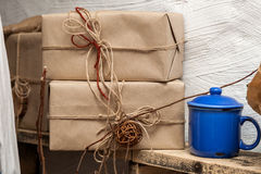 Box wrapped usual gray paper and tied royalty free stock photos