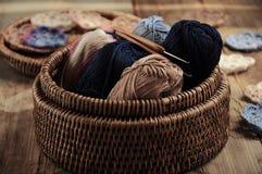 Box of yarn and crocheted flowers. Box of yarn and handmade crocheted flowers Royalty Free Stock Image