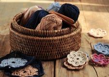Box of yarn and crocheted flowers. Box of yarn and handmade crocheted flowers Royalty Free Stock Photos
