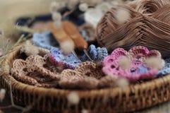 Box of yarn and crocheted flowers. Box of yarn and handmade crocheted flowers Stock Photo