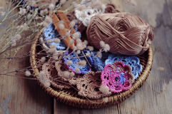 Box of yarn and crocheted flowers. Box of yarn and handmade crocheted flowers Stock Images