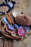 Box of yarn and crocheted flowers Royalty Free Stock Image