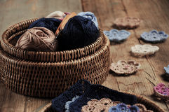 Box of yarn and crocheted flowers. Box of yarn and handmade crocheted flowers Royalty Free Stock Photography