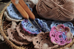 Box of yarn and crocheted flowers. Box of yarn and handmade crocheted flowers Royalty Free Stock Images