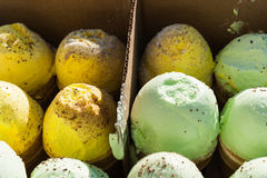 Box of yellow and green ice-creme cones Stock Photos