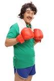 Boxare som poserar med röda boxninghandskar Fotografering för Bildbyråer