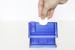 Boxe azul del dinero - casa Foto de archivo libre de regalías