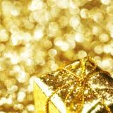 Boxe del regalo dell'oro Fotografia Stock