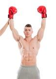 Boxeador del campeón que aumenta ambas manos imagenes de archivo