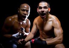Boxeador e instructor chocados Fotografía de archivo