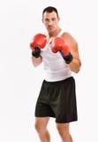 Boxeador en el entrenamiento de los guantes de boxeo Fotografía de archivo libre de regalías