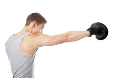 Boxeador joven que hace el sacador Foto de archivo