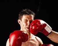 Boxeador que es golpeado Fotografía de archivo libre de regalías