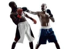 Boxeadores de los hombres que encajonan la silueta aislada Foto de archivo