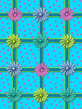 Boxed and Bowed. Aqua background has pink polka dots and is criss-crossed with aqua ribbon outlined in green.  Square gift boxes with coordinating bows sit on Stock Photo