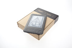 Boxed E-Book Reader Amazon Kindle 3. E-Book Reader Amazon Kindle 3 in box and unboxed one Stock Photo