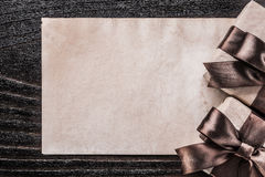 Boxed gift paper on vintage wooden board holiday concept Royalty Free Stock Images