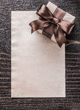 Boxed gift paper on vintage wooden board vertical version Royalty Free Stock Photos