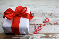 Boxed gift. On wooden background stock images
