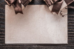Boxed gifts paper on vintage wooden board horizontal view Royalty Free Stock Images