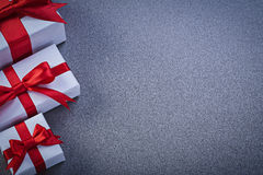 Boxed gifts with presents on grey surface copy space holidays co Stock Images