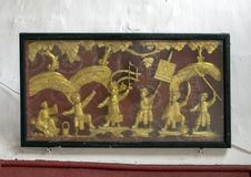 Boxed gold relief of soldiers at war, Cantonese Assembly Hall in Hoi An. Pictured is a boxed gold relief of ancient Chinese soldiers at war in the Cantonese royalty free stock images