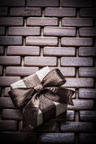 Boxed present box on wooden wicker place mat Stock Photo