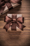 Boxed present containers with brown ribbons on vintage wooden bo Royalty Free Stock Images
