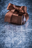 Boxed present with tied bow on metallic background holiday conce Stock Image