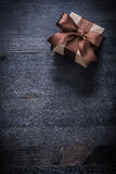 Boxed present with tied bow on vintage wood board copyspace Royalty Free Stock Photography