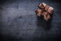 Boxed present on vintage wooden board copyspace holiday concept Royalty Free Stock Photos