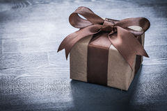 Boxed present on vintage wooden board holiday concept Royalty Free Stock Photo