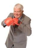 Boxeo maduro acertado del hombre de negocios Fotografía de archivo
